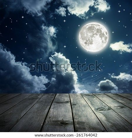 Night sky with stars and full moon, wooden planks. Elements of this image furnished by NASA - stock photo