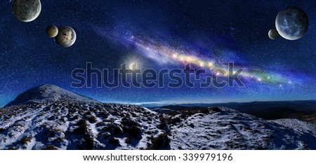 Night space landscape. Milky way galaxy and planets over mountains - stock photo