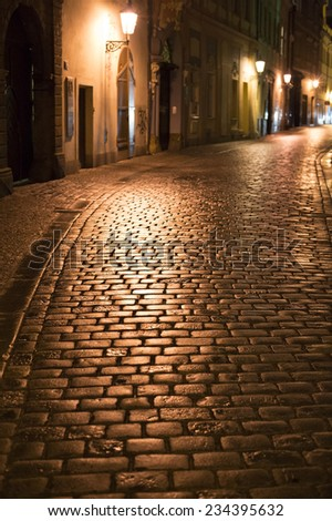 Night street in Prague. Czech Republic. Sharpness on a cobblestones - stock photo
