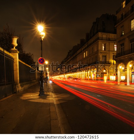night street of a street in Paris with light trails