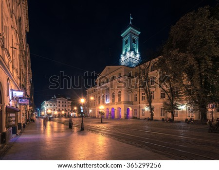 Night summer cityscape in the center of Lviv with Illuminated City Hall on Lviv Market Square