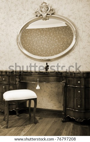 Night table and mirror in a modern bedroom - stock photo