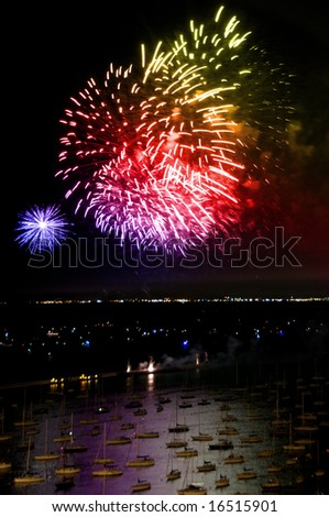 Night time aerial view of downtown Chicago lake-front during independence day fireworks - stock photo