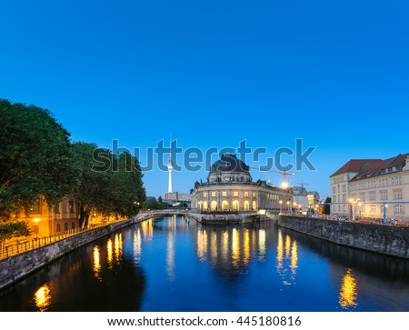 Night time illuminations of Museum Island in Berlin, Germany. Panorama image, that has been tinted. - stock photo