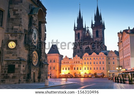 Night time illuminations of the the Old Town Hall (15th Century), Town Square and fairy tale Church of our Lady Tyn (1365) in the Magical city of Prague. Astronomical clock visible. - stock photo