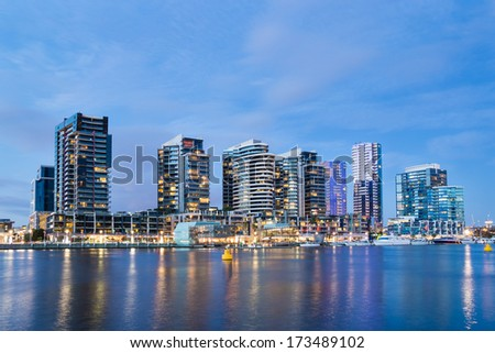 Night time image of apartment buildings in the Docklands area of Melbourne, Australia - stock photo