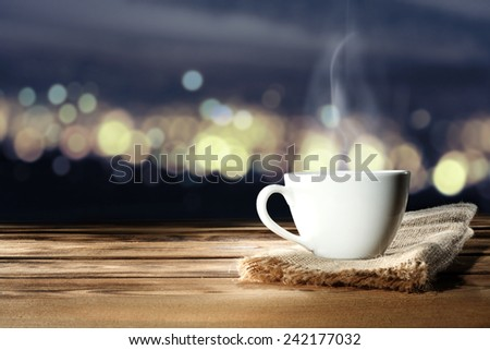night time in city and coffee  - stock photo