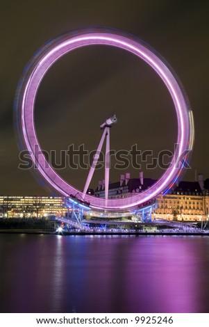 Night-time long exposure photograph of the London Eye (Millennium Wheel) - stock photo