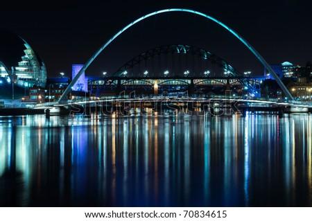 Night-time photograph of the Millenium Bridge over the River Tyne in Newcastle upon Tyne/Gateshead. - stock photo