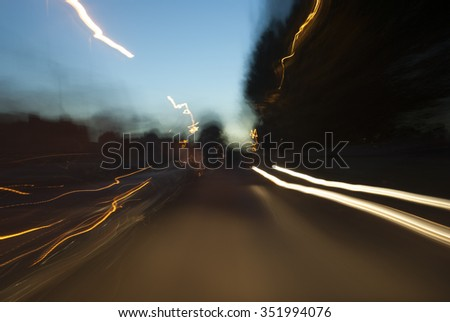 Night time slow shutter shot from inside moving vehicle