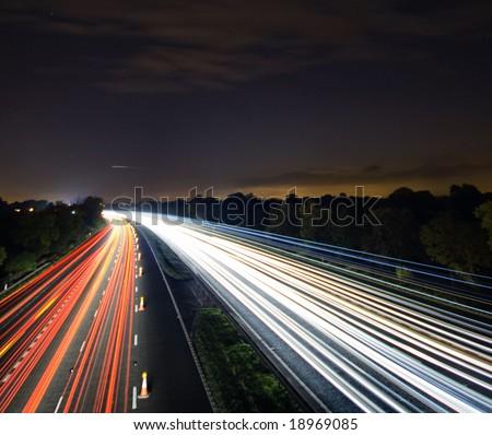Night time traffic motion blur - stock photo