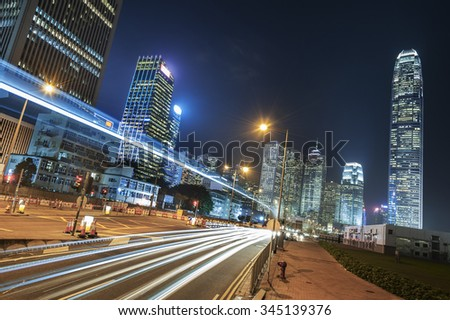 Night traffic and skyline of Hong Kong city - stock photo