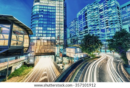 Night traffic around Darling Harbour with car light trails, Sydney. - stock photo