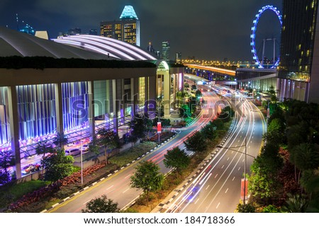 Night Traffic At Urban Road In Singapore City - stock photo