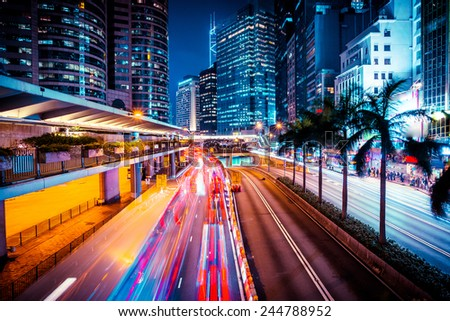 Night traffic in Hong Kong at sunset time, Long exposer - stock photo