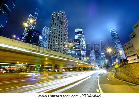 night traffic light trail and city - stock photo