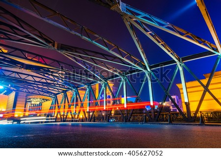 night traffic lights inside of steel bridge - stock photo
