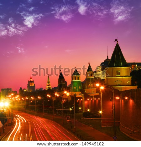 Night traffic near Kremlin wall in Moscow. - stock photo