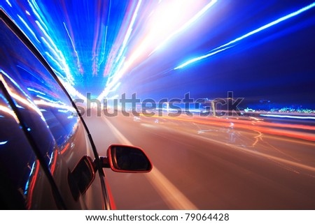 Night traffic,shoot from the window of rush car,motion blur steet light. - stock photo