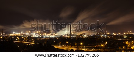 Night view across Port Talbot industrial steelworks and factories in South Wales