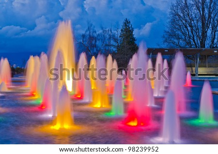 Night view at fountain in Queen Elizabeth park over mountain and cloudy sky in Vancouver, Canada. - stock photo