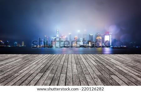night view at shanghai china, huangpu river and bund.blur in the rain. - stock photo