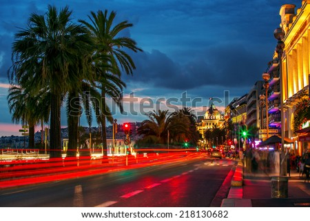 Night View from Nice, France - Mobile people and stable buildings - stock photo