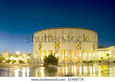 Night view of a hotel with reflexes in the swimming pool, Lanzarote Island - stock photo