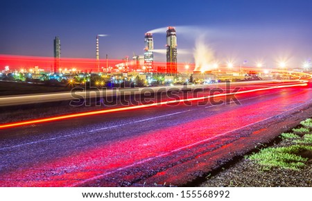 Night view of a plant for the ammonia production with cars light on a background - stock photo