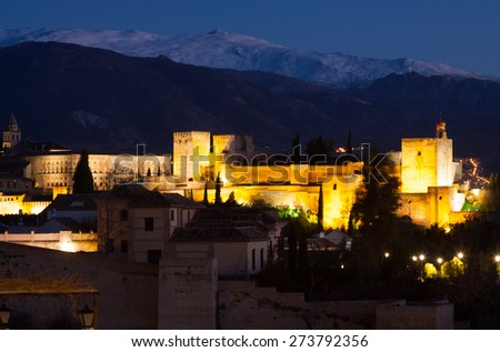 Night view  of  Alhambra with Sierra Nevada in  background.  Granada,  Spain - stock photo