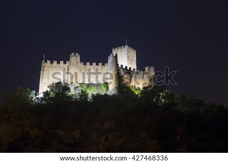Night view of Almourol medieval castle, built in an island in the middle of tagus river.