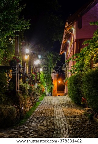 night view of an illuminated street inside of the citadel of romanian city sighisoara