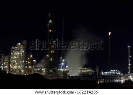 Night View of an Oil Refinery Plant. Horizontal shot