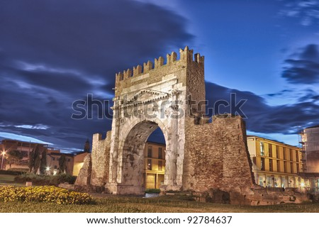 night view of Augustus arch in Rimini - ancient romanesque gate of the city - historical landmark of Italy, the most ancient roman arch that still stands intact - HDR image - stock photo