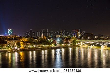 Night view of Basel over Rhine - Switzerland - stock photo