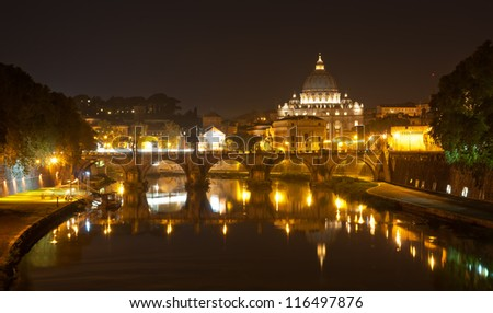 Night view of Basilica St Peter and river Tiber in Roma. Italy