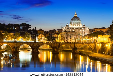 Night view of Basilica St Peter and river Tiber in Rome in Italy