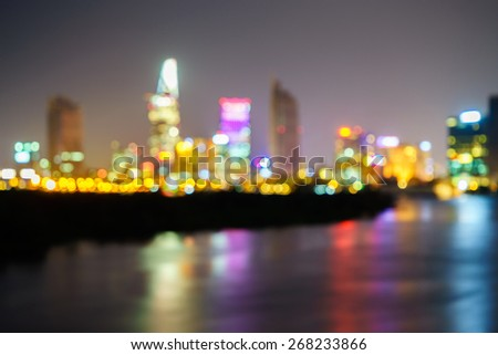 Night view of Business and Administrative Center of Ho Chi Minh city on Saigon riverbank  with defocused bokeh lights as abstract background, Vietnam - stock photo