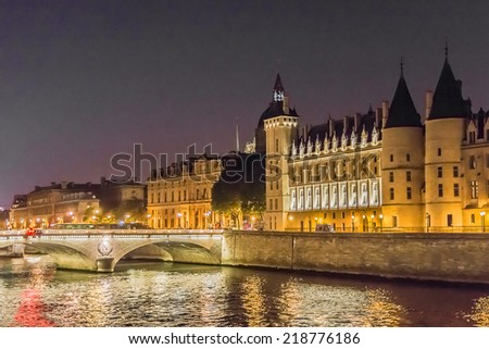 Night view of Castle Conciergerie - former royal palace and prison. Conciergerie located on west of the Cite Island and today it is part of larger complex known as Palais de Justice. Paris, France.
