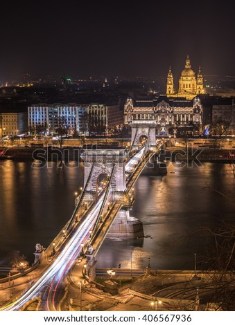 Night View of Chain Bridge over Danube River and St. Stephen's Basilica in Budapest, Hungary. As Seen from Royal Palace in Buda Castle. - stock photo