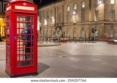 Night view of classic red British telephone box