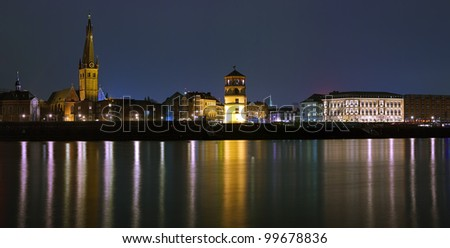 Night view of Dusseldorf Old Town with Basilica of St. Lambertus, Schlossturm and building of old City Hall, Germany - stock photo