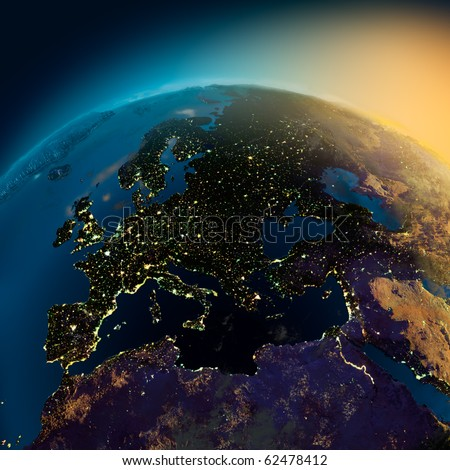 Night view of Europe from the satellite to the glowing lights of towns on the sunrise from the east - stock photo
