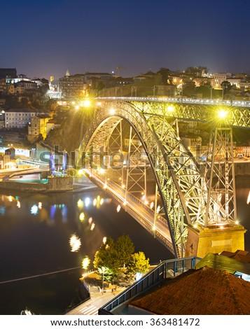 Night view of famous Dom Luis I bridge in Porto . Portugal - stock photo