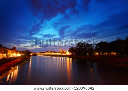 Night view of Florence city with river and illuminated buildings - stock photo