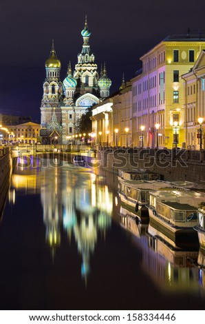 Night view of Griboedov channel and the church of Savior on Spilled Blood (Cathedral of the Resurrection of Christ). St.Petersburg, Russia  - stock photo