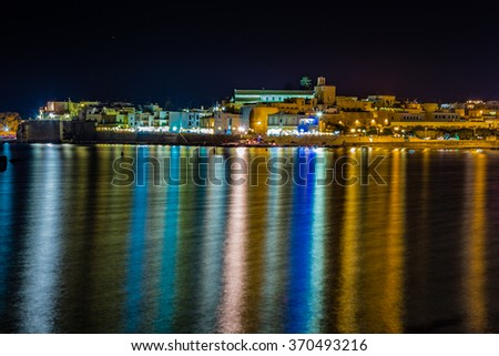 Night view of harbor of ancient city on the Adriatic Sea in Italy