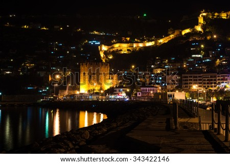 Night view of harbour, fortress and ancient shipyard in Alanya, Turkey - stock photo