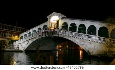 Night view of historical Rialto bridge in Venice Italy - stock photo