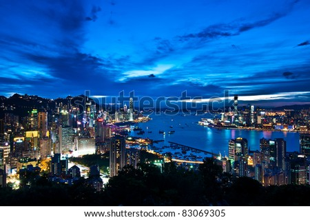 night view of Hong Kong Island and Kowloon Peninsula with blue sky - stock photo